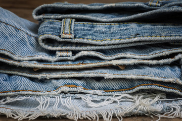 Stack of torn and worn old jean