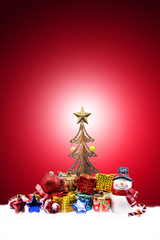 christmas in red background with snowman doll, decorations and gift