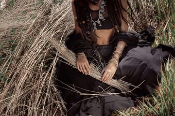 Beautiful young boho woman on grass. Close up