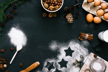 Top view composition of baking ingredients for Christmas cookies