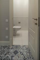 toilet room with the door open