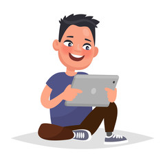 Boy holding a tablet in hands. Vector illustration in cartoon st
