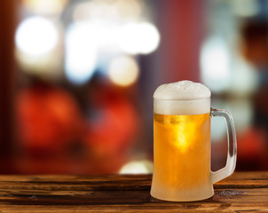 cold light beer glass mug in a pub