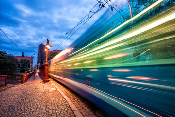 Fast moving tram blurred light trail on Sandy Bridge. Wroclaw, Poland.