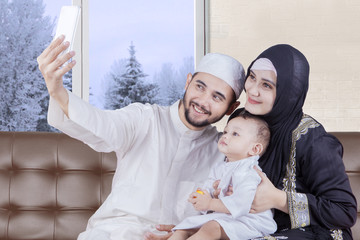 Arabian parents and boy taking selfie picture