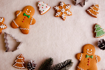 beautiful Christmas background with gingerbread men, Christmas trees and snowflakes with pine cones