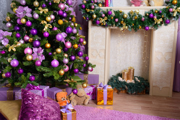Christmas tree decorated in purple toy. background with gifts