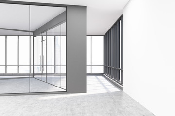 Empty office with glass and white concrete walls