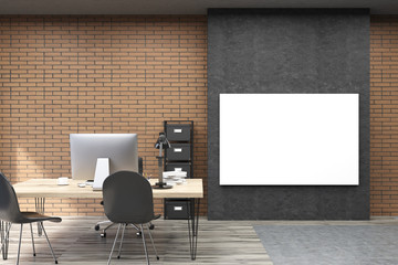 Front view of horizontal poster on black wall in CEO study