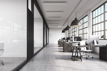 Front view of a long office with concrete floor