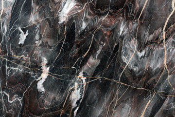 Mulicolored dark natural marble. Background of natural stone.