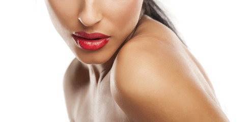 beautiful feminine lips with red lipstick and naked shoulders