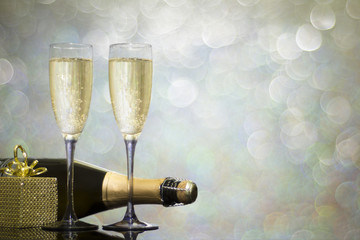 Festive decoration with two glasses of champagne and a blurred background