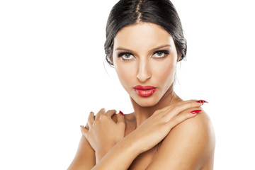 good makeup, artificial eyelashes and red lipstick, long nails and bare shoulders