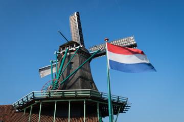 Netherlands flag and windmill at Zaanse Schans, Netherlands