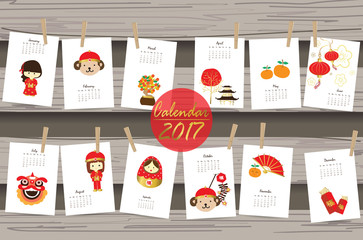 Colorful cute monthly calendar 2017 with monkey,doll,orange in c