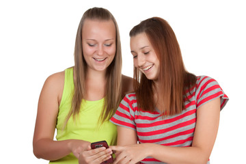 Portrait of lovely young women using mobile phone together