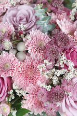 Closeup of pink chrysanthemum, roses and astrantia flowers