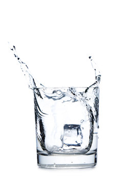 Glass of water with ice cube isolated on a white