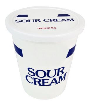 Container of sour cream. Vertical.