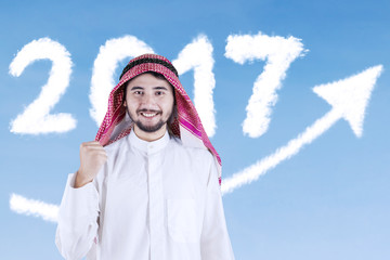 Arabian businessman with numbers 2017 and arrow