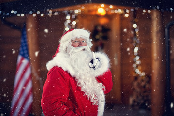 Santa Claus holding finger on mouth