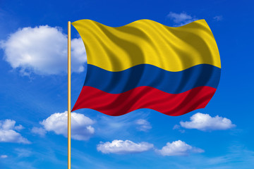 Flag of Colombia waving on blue sky background