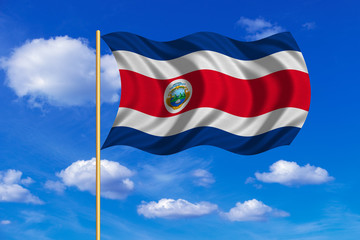 Flag of Costa Rica waving on blue sky background