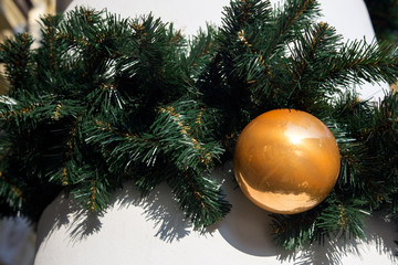 Holiday decor with fir and golden globe