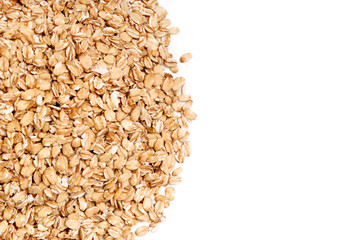 Uncooked oat flakes on white background. Close up, top view, high resolution product. Healthy food Concept.
