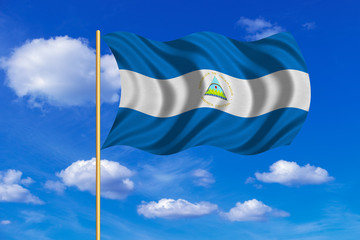 Flag of Nicaragua waving on blue sky background