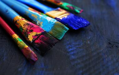 paintbrushes in dark background