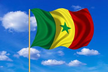 Flag of Senegal waving on blue sky background