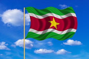 Flag of Suriname waving on blue sky background