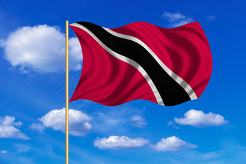 Trinidad and Tobago flag wavy on blue sky backdrop