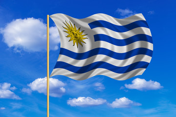 Flag of Uruguay waving on blue sky background