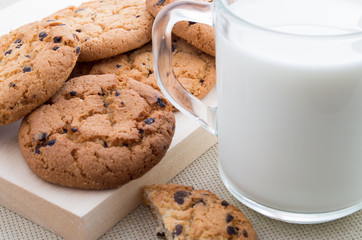 Transparent cup with milk and oatmeal cookies