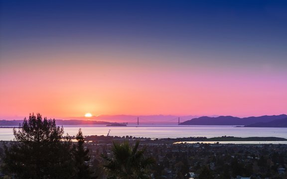 Panorama sunset view of San Francisco Golden Gate Bridge and Berkeley