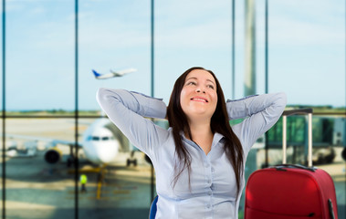woman smiling at the airport