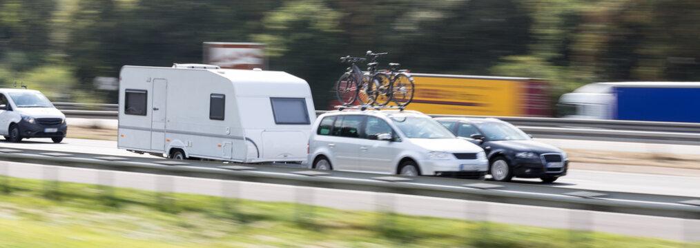 car with a caravan highway speed blur
