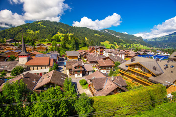 Old city center of Gstaad village, famous ski resort in Swiss Alps, canton Bern, Switzerland