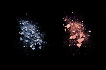 pink broken and spilled eye shadow on a black isolated background