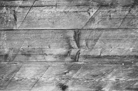 Barn wall abstract naturaly weathered wooden shabby rustic dirty planks closeup black and white background texture