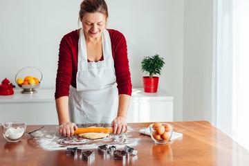Woman preparing Christmas Cookies at home