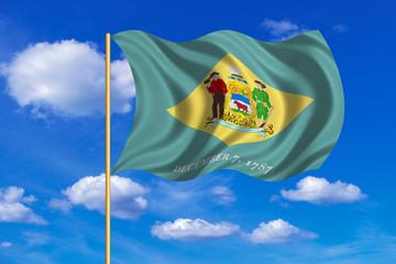 Flag of Delaware waving on blue sky background
