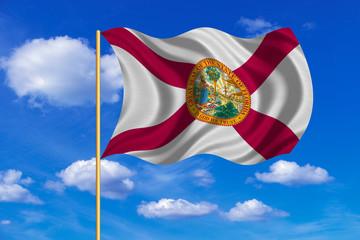 Flag of Florida waving on blue sky background