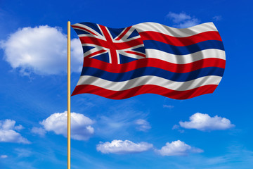 Flag of Hawaii waving on blue sky background