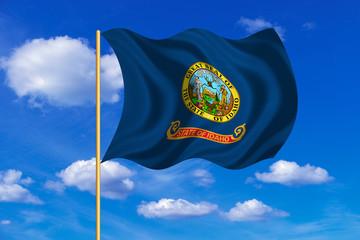 Flag of Idaho waving on blue sky background