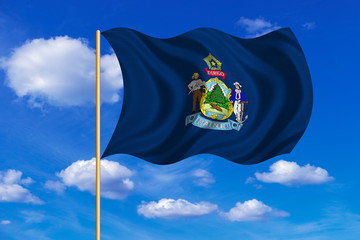 Flag of Maine waving on blue sky background
