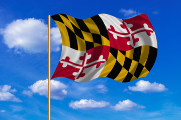 Flag of Maryland waving on blue sky background